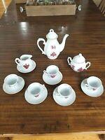 Porcelain Gold rimmed Tea Set with saucers, tea Pot, creamer and sugar bowls