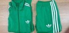 Adidas Green Jacket + Pants, Red Pants.