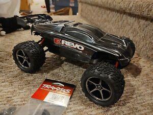1:16 scale Traxxas 4x4 VXL E-Revo Brushless Roller Un-used parts w/2080 servo
