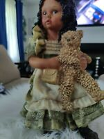 Porcelain Doll holding Teddy Bear and Purse  11inches tall 6inches Wide...