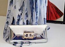 #8 New Tory Burch Gigi Metallic Silver Patent Leather Clutch   $258