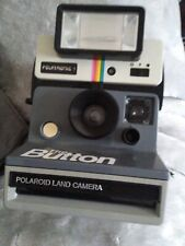 Polaroid land camera the button, with flash. Collectors item.