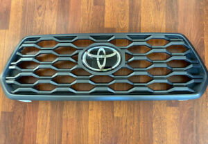 GENUINE OEM TOYOTA TACOMA TRD SPORT  GRILLE EMBLEM OEM In Really Good Condition