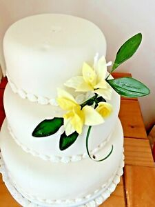 WEDDING CAKE SUGAR SPRAY IN  YELLOW LILLES AND ROSE    PRICED TO CLEAR