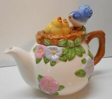 Teapot Blue Bird Mom and Yellow Baby Birds in Nest Pink and Purple Flowers