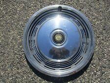 one 1973 1974 Pontiac Grand Safari Grandville hubcap wheel cover