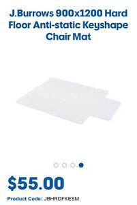 J. Burrows 900 x 1200 mm hard floor clear anti-static key shape chair floor mat