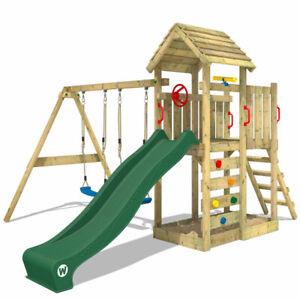 WICKEY Spielturm Klettergerüst MultiFlyer Holzdach mit Schaukel & grüner Rutsche
