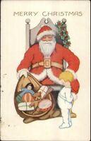 Christmas - Cute Little Boy & Santa Claus - Toy Sack c1920 Whitney Postcard