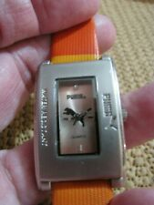 "PUMA- LADIES ORANGEY WATCH SILVER TONE 1""WIDE N 1-1/2""LONG RECTANGLE CASE RUNS"