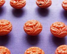Set 8 old/vintage diminutive orange glass buttons pressed with a single flower