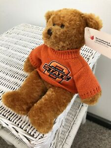 OSU Bear Wearing An Orange Turtleneck Sweater With Logo Embroidered On Fr