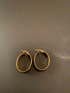 14 karat gold oval earrings, never worn