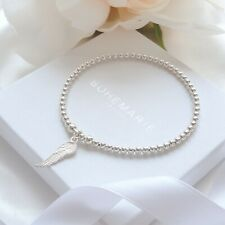 Sterling silver angel wing charm bracelet, dainty beaded stacking jewellery