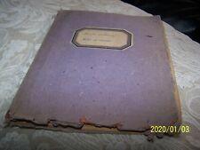 Ancien cahier de travaux de couture de l'année 1946. Nombreux échantillons.