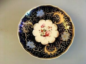 Attractive 19th Century porcelain saucer decorated with flowers  21/550S