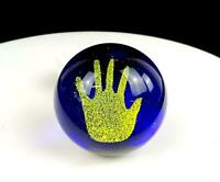 "STUDIO ART GLASS COBALT BLUE YELLOW HAND IN SAND 2 1/2"" ROUND PAPERWEIGHT"