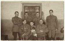 THE DOG SOLDIERS: SEVEN SOLDIERS AND THEIR MASCOT JACK RUSSELL TERRIER  (RPPC)