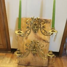 Pair of antique cupid candle sconces with prisms
