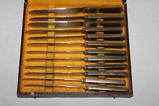 12 couteaux de tables des années 50. Bronze d'art. Signé Grissolange Pouzet