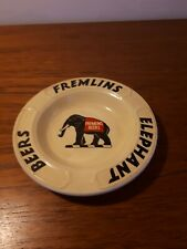 A VINTAGE FREMLINS ELEPHANT BEERS ASBTRAY