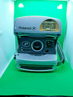 vintage polaroid p 600 instant film camera in silver,in good condition.