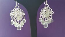 GREEN AMETHYST GRADUATED FACETED DROPS AND SILVER PLATED COPPER EARRINGS.