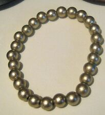Lovely elasticated beaded bracelet with gold tone sparkling beads