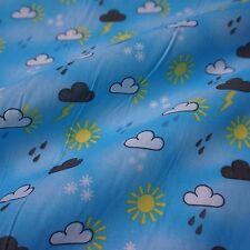 Blu tessuto in policotone con simboli meteorologici (per metro) nuvole SOLE PIOGGIA NEVE