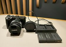 Canon EOS M6 Mirrorless Camera With a Wide-angle Lens (was bought independently)