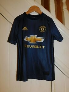 BOY'S MANCHESTER UNITED AGE 9 -10 YEARS ADIDAS NAVY FOOTBALL TOP CHEVROLET