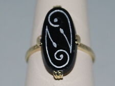 14k Gold ring with an Onyx and beautiful design