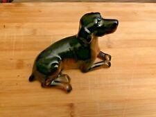 Gordon Setter Ceramic black and brown dog figurine Lying down.