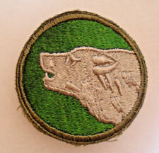 WWII ONE TOOTH VARIANT OF 104TH TIMBERWOLVES SOLID WHITE BACK ORIGINAL C.E.