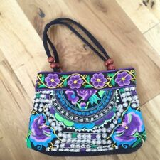 Beautiful embroidered floral cloth handbag with wooden beads