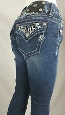 MISS ME SIZE 27 MID RISE  BOOT CUT BY ROCK REVIVAL