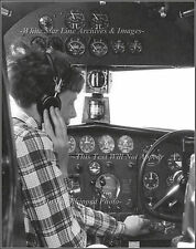 Photo: Amelia Earhart In Her Electra Tuning The 27A Remote Radio