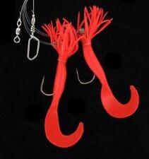 Esche e mosche rosso per la pesca in acqua salata
