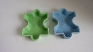 Set of 2 puzzle piece dishes, one blue and one green