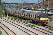 Class 320 ScotRail 320315, 3 car EMU, in Carmine & Cream with 08669 at Doncaster