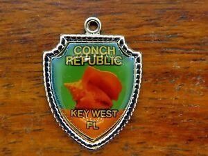 Vintage silver CONCH SHELL REPUBLIC KEY WEST FLORIDA TRAVEL SHIELD charm 44-11