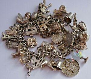 Superb vintage solid silver charm bracelet & 37 charms, rare,open,move, 111.9g