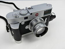 WHITE LENS STOPPER. PROTECTS COLLAPSIBLE LENSES ON CAMERA BODIES LEICA M9 M 240