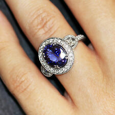 Oval Tanzanite Halo Ring with Half Moon Diamond's in 18kt White Gold 3.80ctw