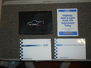 2004 Chevrolet SSR owner's manual with black SSR case.