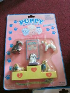 Vintage/Collectable Puppy In My Pocket with yellow podium inc 5 dogs sealed (3)