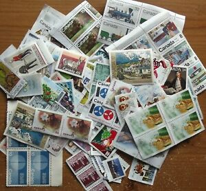 CANADA STAMPS. $80 OF UN-FRANKED GUM LESS.