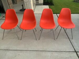 4 Herman Miller Eames Plastic Side Chairs on H Base Red/Orange