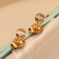 100% Genuine 9K Yellow Gold Stud Earrings with Clear Bezel Set Stone.