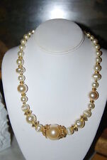 VINTAGE PLASTIC FANCY FAUX PEARLS WITH GOLD TONED ACCENT CENTERPIECE NECKLACE